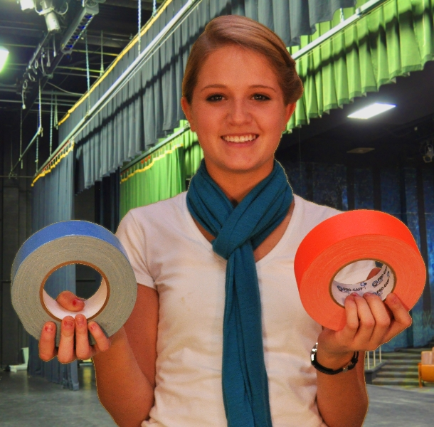 girl holds blue and orange gaffers tape in theater